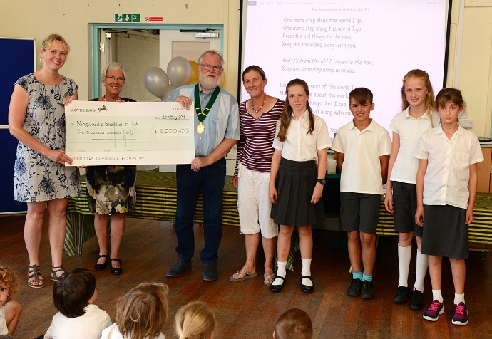 Shalfleet - Shalfleet CE Primary School - Parish Council presenting Year 6 Leavers with a dictionary and a cheque for £5000 for new play equipment - Lyn Brading Palmer, Helenna Hewston, Steve Cowley, Jojo Minchin, Isabelle Minchin 11, Joe Calder 11, Katherine Brading-Palmer 11 and Laura Brading-Palmer nine